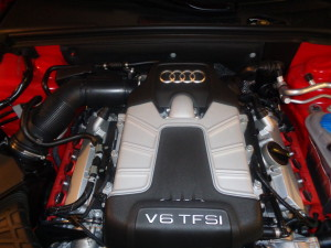 Underhood, once for V-8, now houses supercharged V-6