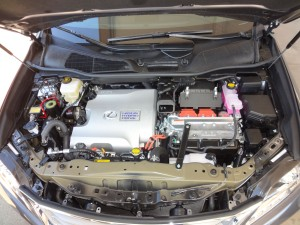 The Lexus gas/electric hybrid drive setup beneath the hood of 2015 RX450h.