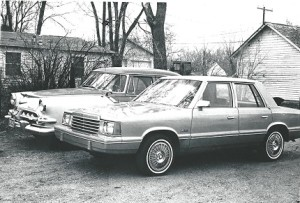The 1981 Dodge Aries parked beside a 1956 Dodge Royal four-door. (Bud Wells photo)