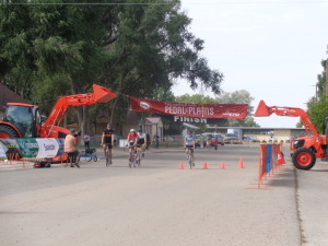 Bike riders at finish of Pedal the Plains in Wiggins.