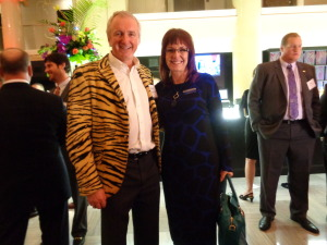 "Among those greeting Glenwood Springs car dealer Michael Payne in his ""tiger-striped"" jacket was Charlene Bowlin of Security Service Federal Credit Union. At right is Casey Tynan. (Jan Wells photo)"