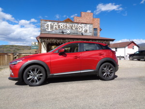 The 2016 Mazda CX-3 compact crossover parks briefly out front of the Tabernash Tavern. (Bud Wells)
