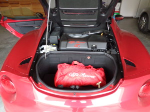 Directly behind the Alfa's rear engine is a small trunk.