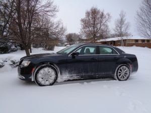 The Chrysler 300 AWD back in its driveway, already cleared of snow, after icy outing. (Bud Wells photo)
