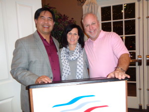 David Muramoto, left, new president of the Rocky Mountain Automotive Press, is with Kelley Enright of FiatChryslerAutomotive in Chicago, and Kurt Hansen, broadcast host of Race Central. (Jan Wells photo)