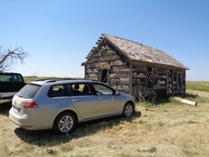 The new Volkswagen Golf SportWagen sits outside a near-100-year-old homestead shack in northwestern Logan County. (Jan Wells photo)