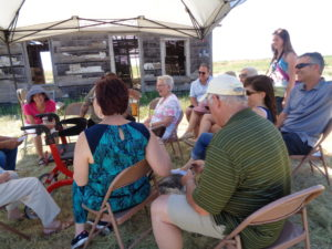 Beneath canopy in 93-degree heat, group enjoys discussion of the Carey homesteading days beginning 100 years ago, above and below. (Bud Wells photos)
