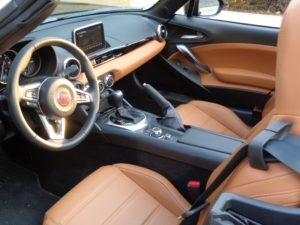 The Spider's interior, trimmed in leather, is attractive and relatively comfortable.