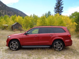 A cardinal red Mercedes-Benz GLS550 adds beauty with the yellowing aspen leaves near the old Kinikinik store in Poudre Canyon. (Bud Wells photo)