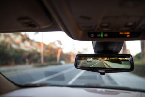 With push of button, rearview mirror becomes live video of what's behind. (Cadillac)